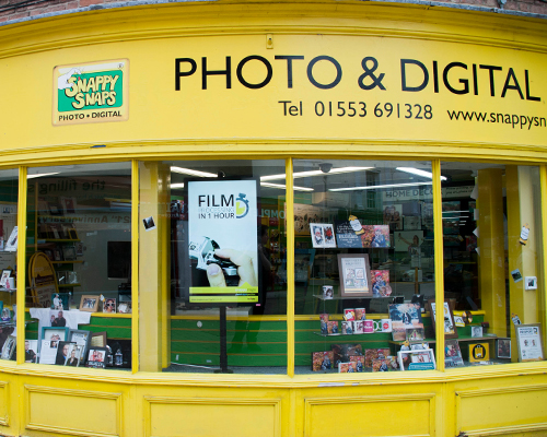inVoke Digital Signage outward-facing advertising screen installation at Snappy Snaps