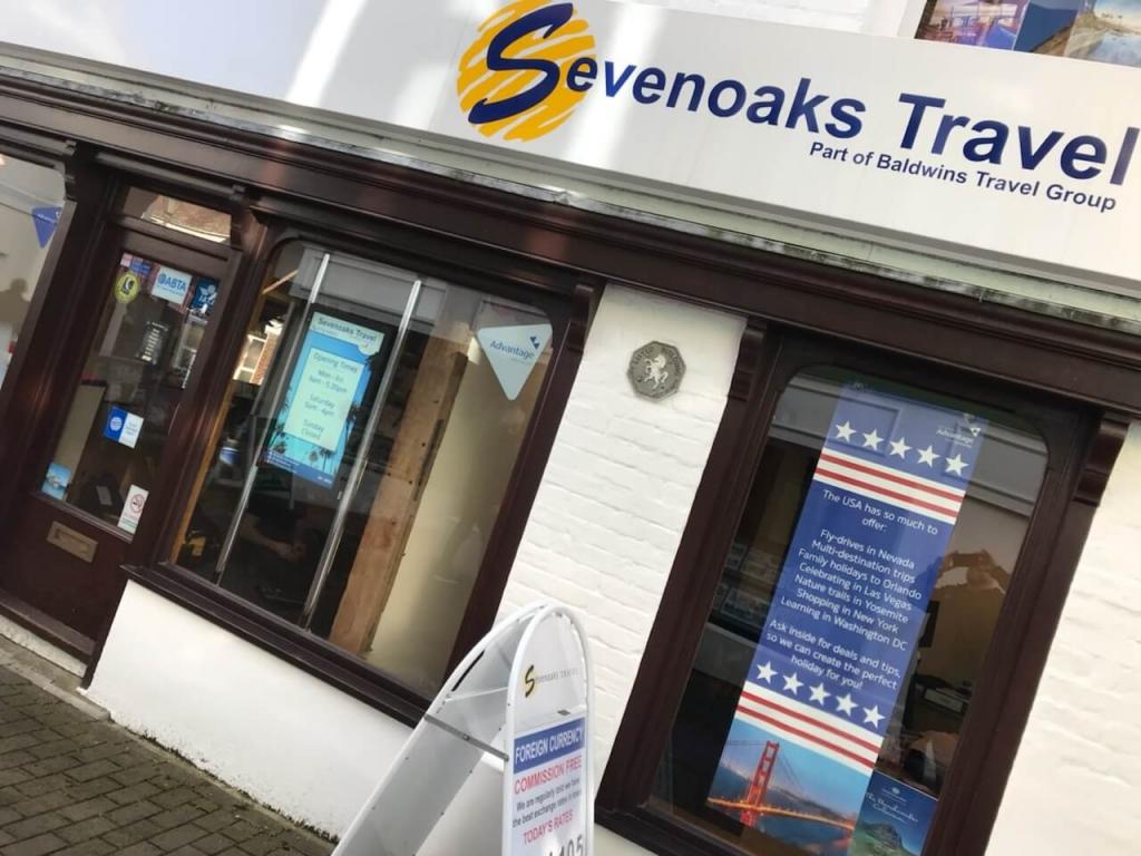inVoke Digital Signage outward-facing advertising screen at Sevenoaks Travel